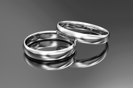 White Gold Wedding Rings on black reflective background. 3D Rendering Stok Fotoğraf