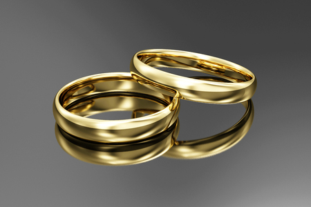 Golden Wedding Rings on black reflective background. 3D Rendering
