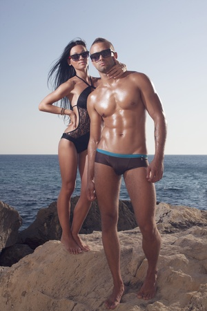 oiled: Sporty couple with oiled bodies