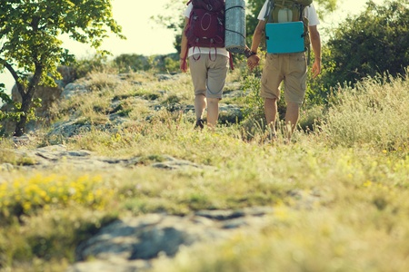 Tourists couple hiking with backpack photo