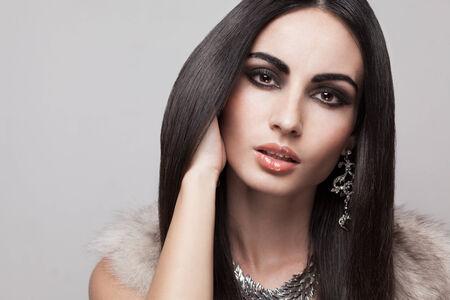 Face of fashionable caucasian model in beige fur vest photo