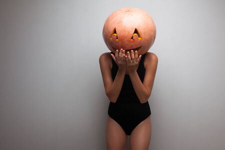 Funny pumpkin face. Dancer in Halloween costume. photo