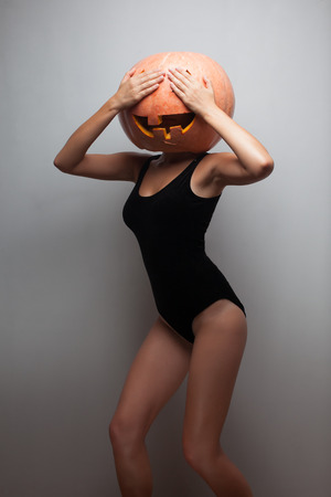 Funny dancing Halloween go-go dancer girl. Idea for Halloween poster, placard, affiche or bill photo