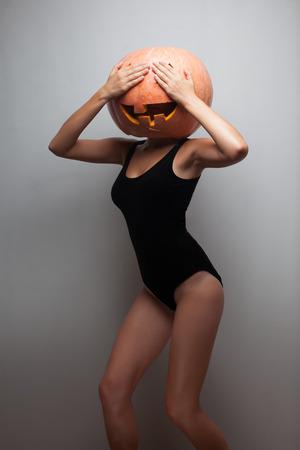 Funny dancing Halloween go-go dancer girl. Idea for Halloween poster, placard, affiche or bill