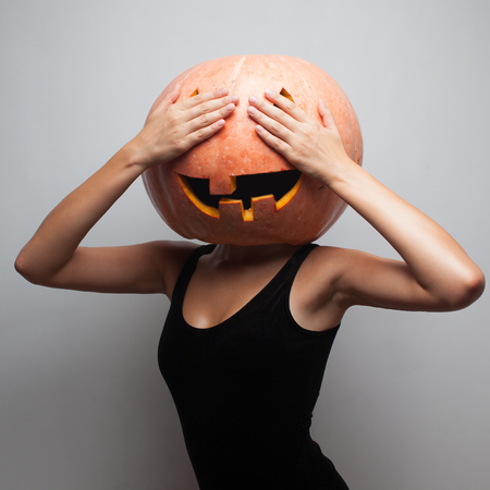 Funny pumpkin face. Dancer in Halloween costume. Covered eyes photo