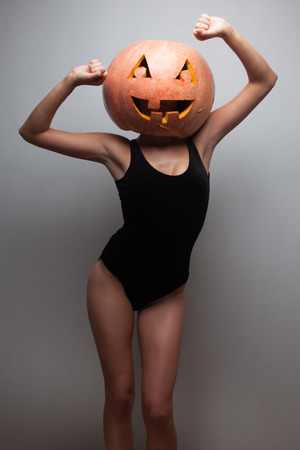 Dancing Halloween go-go dancer girl. Grey background. Idea for Halloween poster, placard, affiche or bill