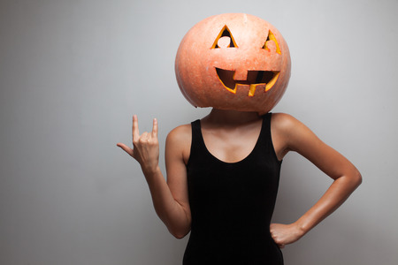 Pumpkin face. Dancer standing in Halloween costume. Stock Photo