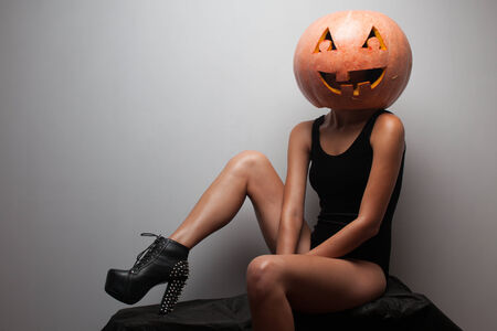 Fashionable halloweens model sitting photo