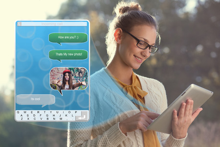 Concept of using wireless technology, video call, typing message on ipad  Incoming call  interface of tablet pc photo