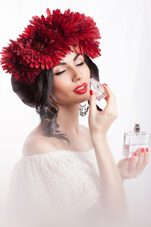 Fashionable woman smelling perfume photo