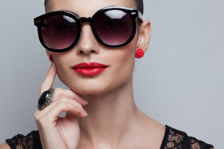 Closeup of perfect model in big rounded sunglasses. text space and copy space photo