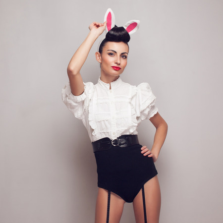 Sexy pinup model posing in vintage bunny costume photo