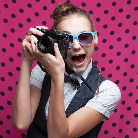 Expressive portrait of female photographer