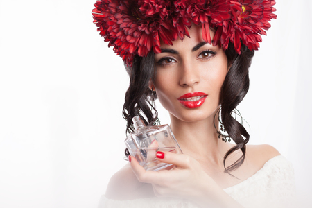 Closeup of fashionable model with parfume bottle photo
