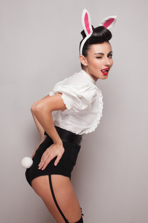 playful bunny girl winking and tongue out. pinup style Reklamní fotografie - 26416368