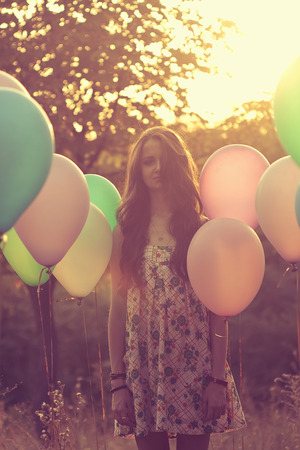 Emotive portrait of girl with balloons photo
