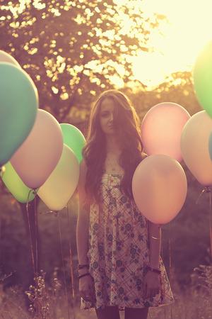 emotive: Emotive portrait of girl with balloons Stock Photo