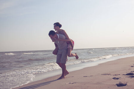 couple having fun and playing on the sea photo