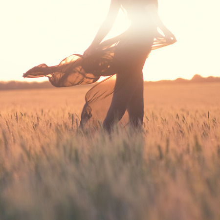silhouette of woman body in the field photo