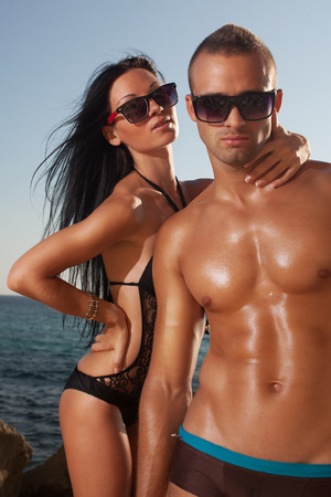 Oiled perfect bodies couple posing photo