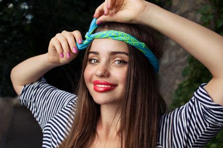tucker: trendy teenager model with kerchief posing on flowers BG