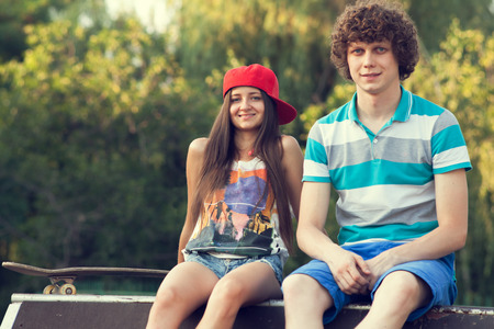 cool girl: Couple of teenagers sitting during rest in the park