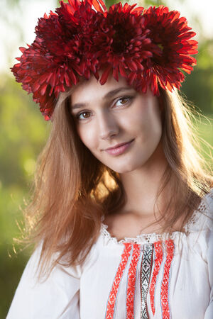 Close-up portrait of ukranian girl in traditional costume Stock Photo