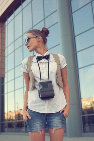 Stylish girl posing on urban background photo