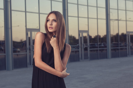 Portrait of fashionable woman in black dress photo