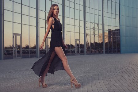 high street: Walking woman in long black dress