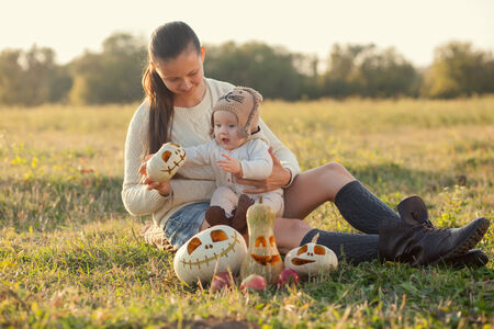 Mother showing baby pumpkin photo