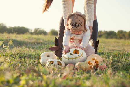 Little baby seeing halloween pumpkin first time photo