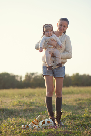 Portrait of fall styled mothet and baby photo