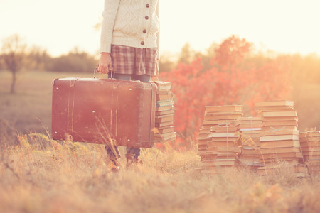 Hipster girl holding a suitcase Stock Photo