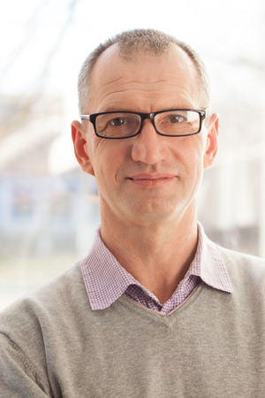Closeup portrait of casual style adult man in glasses