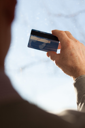 non cash: Senior male hands holding a plastic card