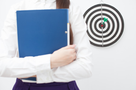 bullseye: Businesswoman and good result. Focus on board