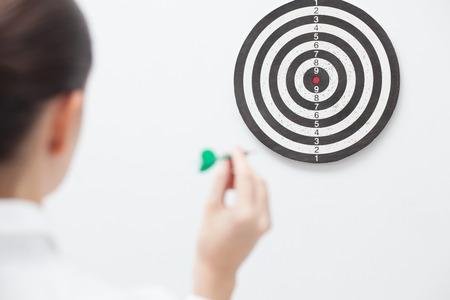 Businesswoman trying hit bullseye Reklamní fotografie