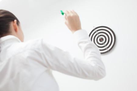 bullseye: Businesswoman trying hit bullseye Stock Photo