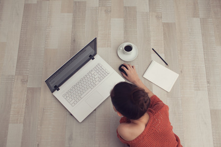 top view of clicking a mouse woman
