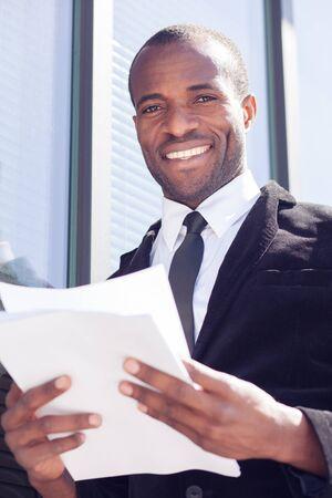 handling: happy black businessman documents handling Stock Photo