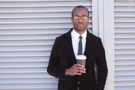 trendy black man have coffee break outdoors