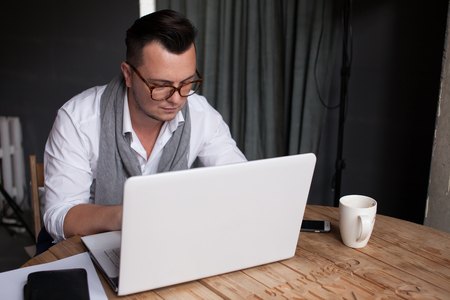 Stylish Man using laptop in office