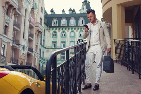 Stylish man walking after luxury shopping Archivio Fotografico