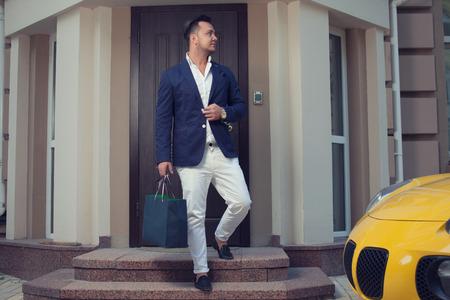 Rich man leaving house Reklamní fotografie - 45043478