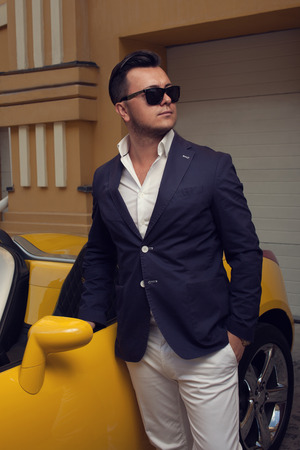 life style: Stylish man posing with convertible sportcar