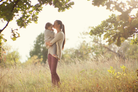 casual fashion: Mother and toddler walking outdoors Stock Photo