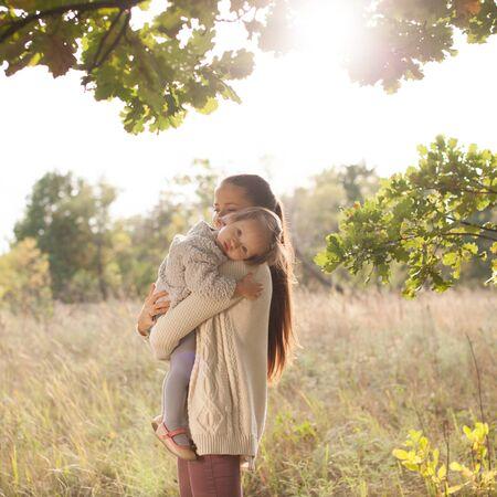 toddler walking: Mother and toddler walking outdoors Stock Photo