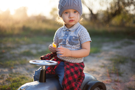 speedster: Toddler posing with toy race car