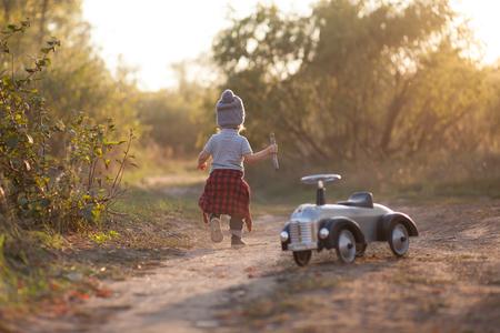 speedster: Toddler running during park stroll Stock Photo